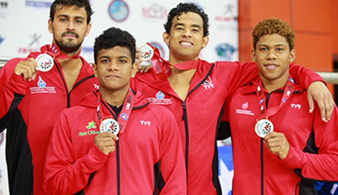 Members of T&T's Gold medal winningBoys 18+ 400m Freestyle Relay team, Dylan Carter, Tariq Lashley, Joshua Romany and Jabari Baptiste, during day 3 of the XXX CCCAN Swimming Championships 2017, at the National Aquatic Centre, Couva.