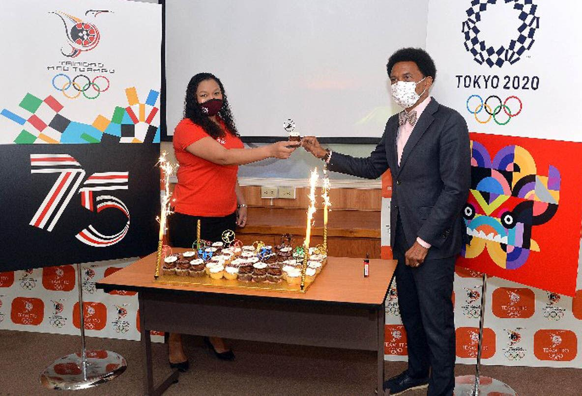Trinidad and Tobago Olympic Committee (TTOC) president Brian Lewis, right, and Team TTO chef de mission for the July 23 - August 8 Tokyo Olympic Games, Lovie Santana, toast over some commemorative Team TTO cupcakes. —Photo: ROBERT TAYLOR